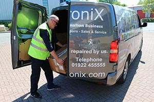 man loading repair collection into van